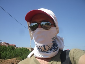 Keeping the dust, sun, exhaust fumes, and flies out of my face with this weird getup. I get a lot of stares...